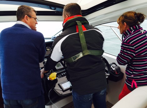 A skipper helps the latest Sunseeker owners get to grips with their new  Portofino 48