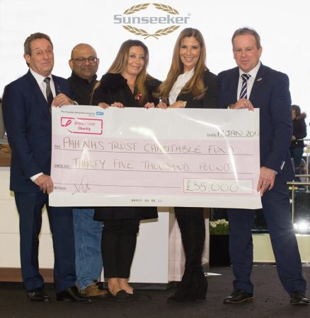 The Sunseeker Group present the £35,000 cheque to Ashraf Patel and Victoria Gerlis