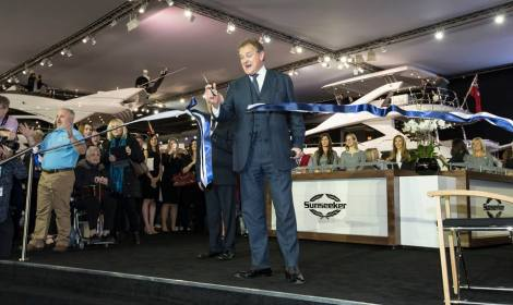 Hugh Bonneville cuts the ribbon to launch the Sunseeker stand at the London International Boat Show