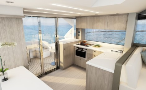 The galley doubles up as a bar and opens up the whole main deck as an entertainment space, with hinged glass doors opening upwards and outwards to create a unique inside/outside environment for owners to enjoy hosting family and friends.