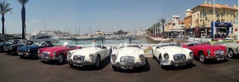 A display of the Algarve Classic Cars from the event over looking the Vilamoura Marina