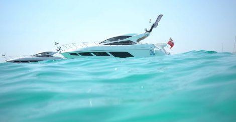 The stunning Sunseeker Predator 57 in the aqua blue seas outside Es Trenc Beach