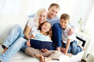 Happy Family Reading A Book - AC Replacement - Fort Myers FL - Sunset Air and Home Services - 239-693-9005 - 480 x 320
