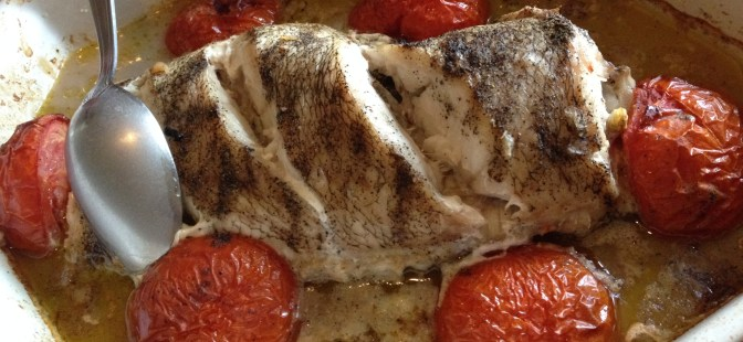 Baked fish with tomatoes