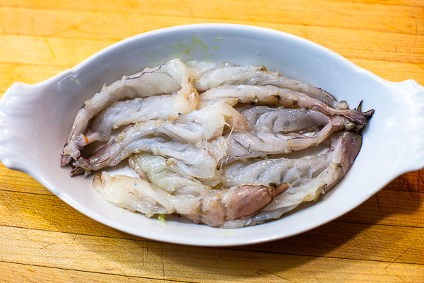 butterflied shrimp packed in white dish
