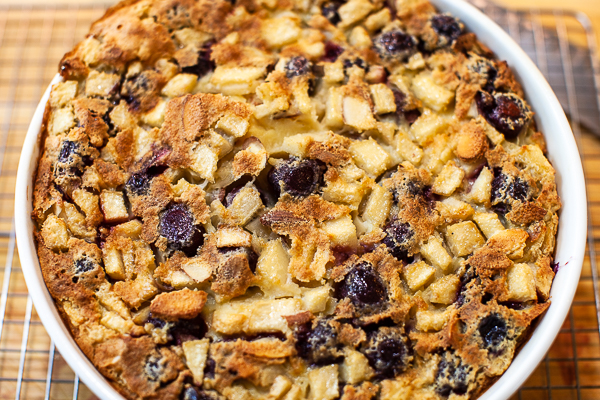 dish containing puffed up clafoutis with golden brown top
