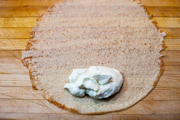 cream cheese mixture on bottom edge of crepe
