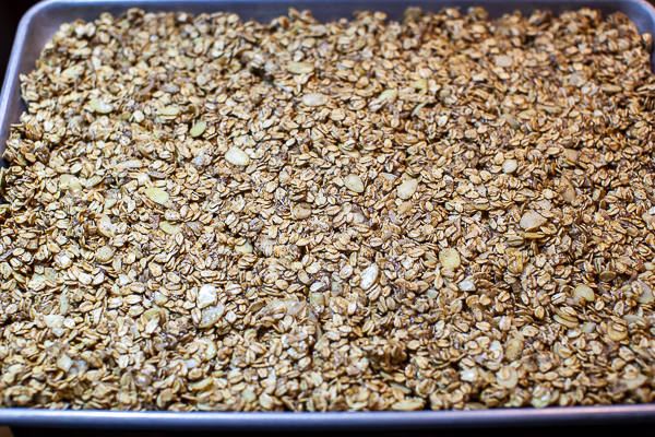 sheet pan containing granola spread to the edges