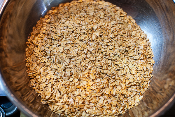 metal mixing bowl containing rolled oats
