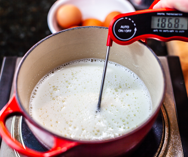Pot of ice cream custard with thermometer reading 185