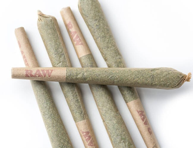 pre rolled joint laying across four others