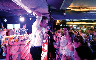 AMAGANSETT, NY - AUGUST 07:  (EXCLUSIVE ACCESS) Chris Martin of Coldplay performs for SiriusXM in the Hamptons at The Stephen Talkhouse: Performance Airs Live on SiriusXM on August 7, 2016 in Amagansett, New York.  (Photo by Kevin Mazur/Getty Images for SiriusXM)