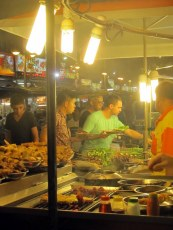 Husband picking out food for cooking, Kuala Lumpur