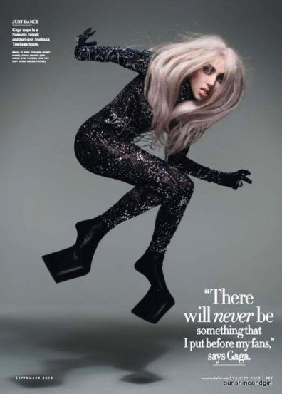 Lady Gaga photographed for Vanity Fair wearing the bodysuit and boots on display at GOMA