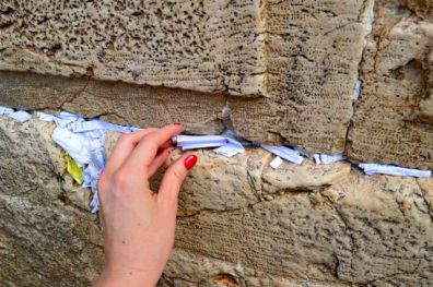 Placing a prayer in the wall