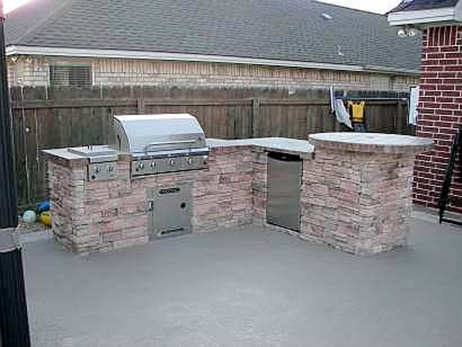 stacked stone outdoor kitchen tile countertops living photos bryan college station pool builder