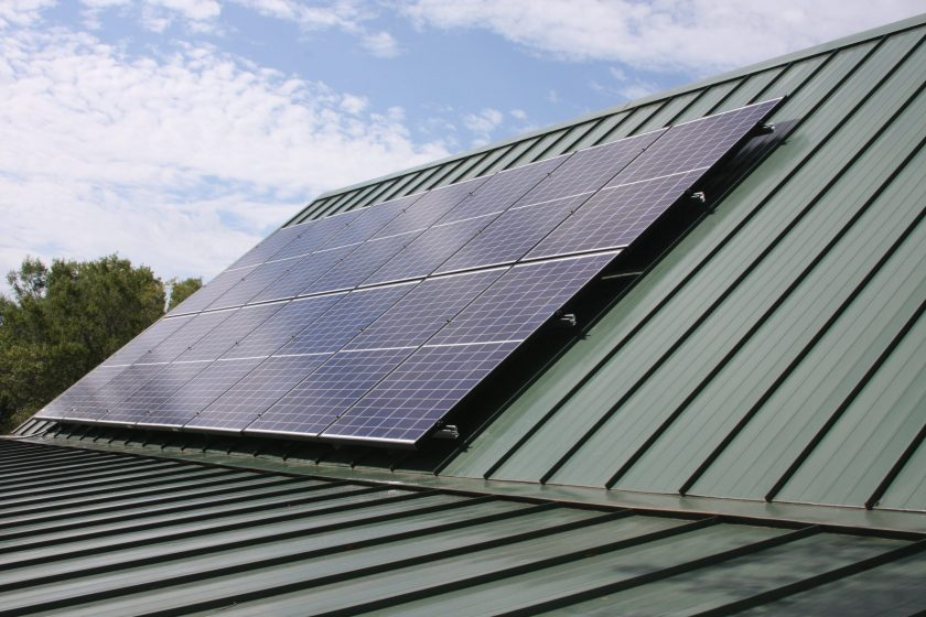 solar panels mounted to a roof in Junction, TX