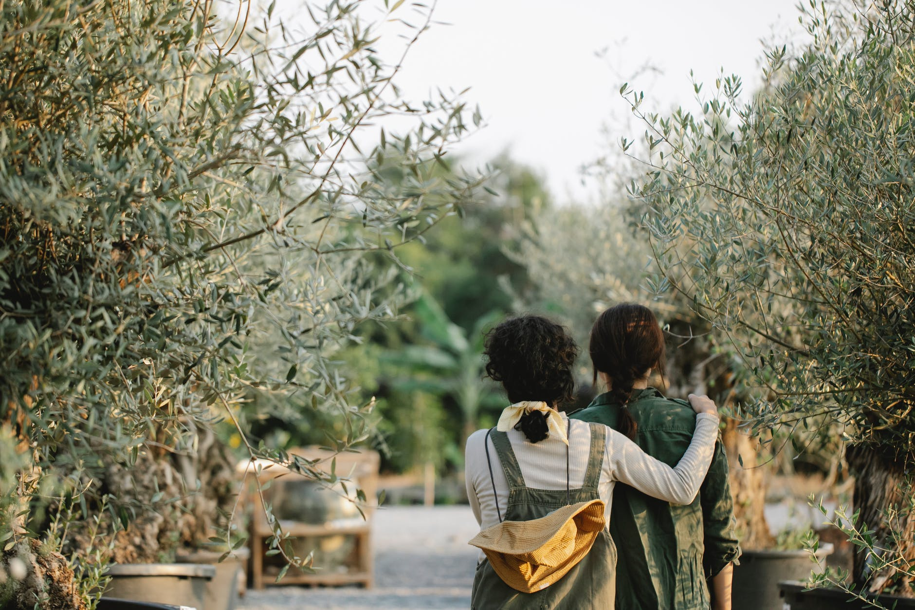 unrecognizable gardeners in botanical garden