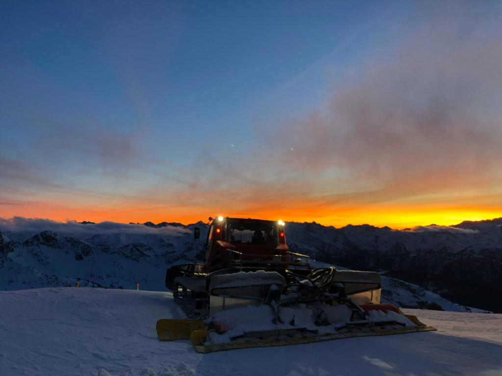 Piste groom with a beautiful sunset in Baqueira Beret