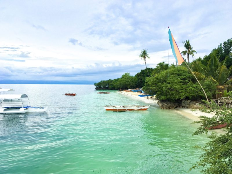 best things to see and do in siquijor island - paliton beach with fishermen boats