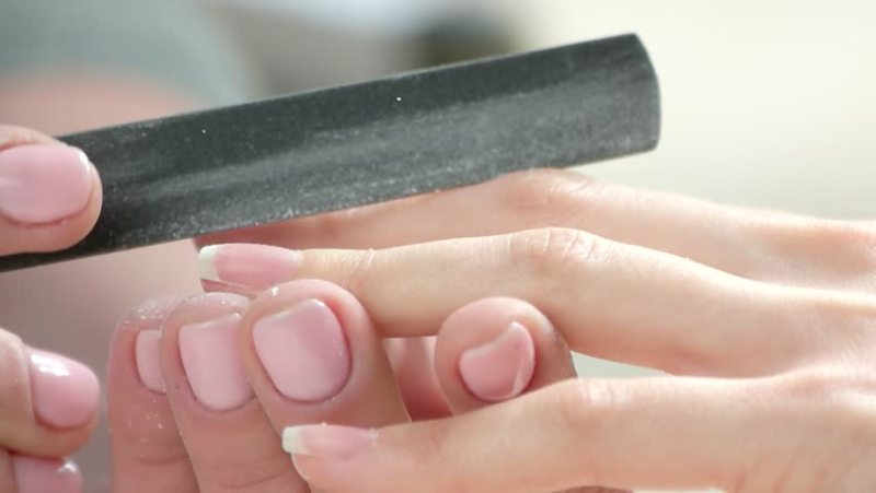 how to protect your nails in summer - filing toe nails