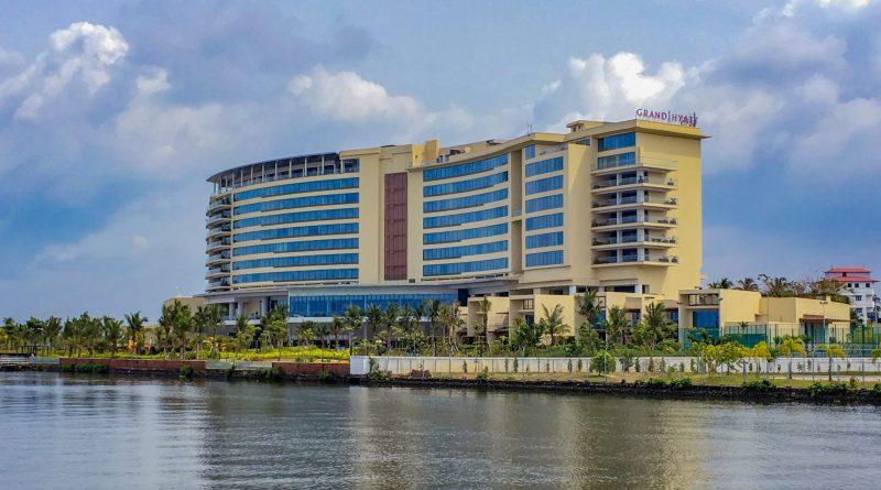 view of the grand hyatt kochi bolgatty building from the water