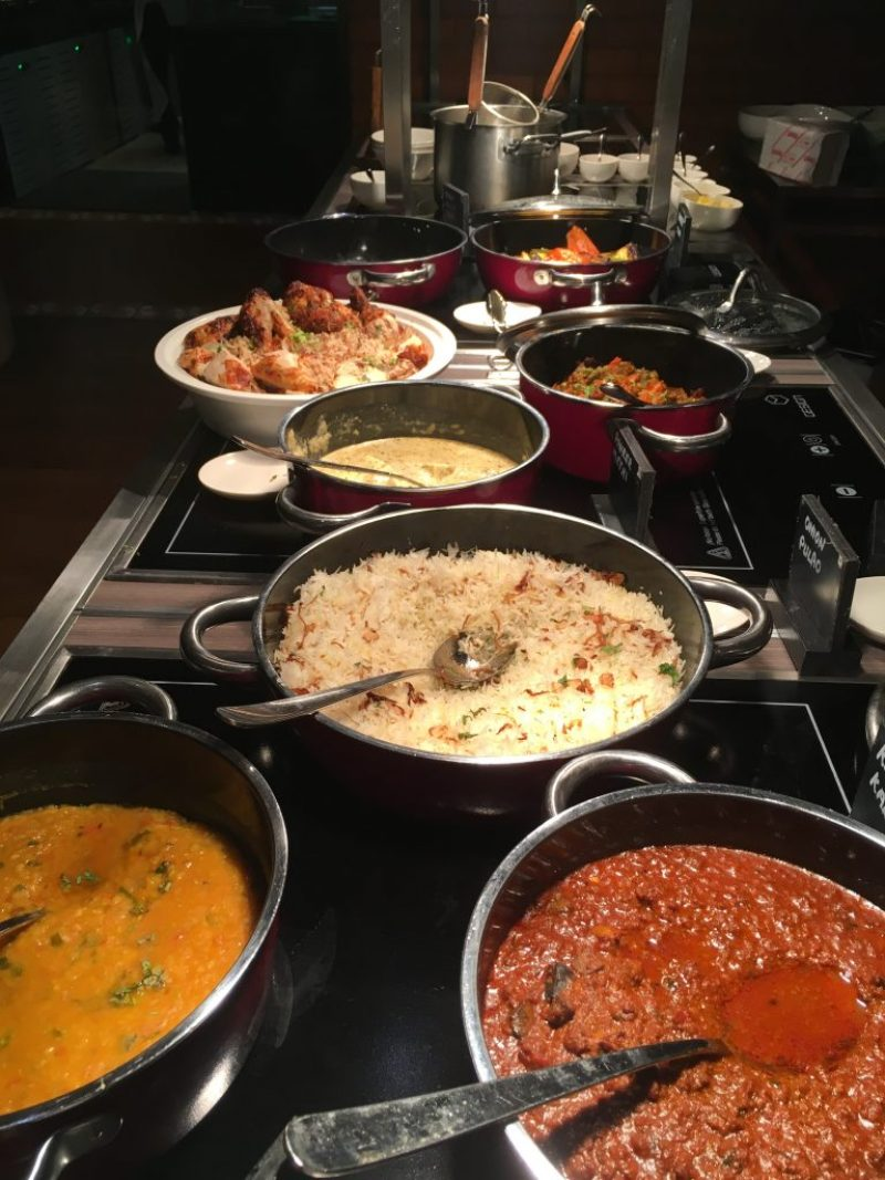 selecion of north indian curries on the stove