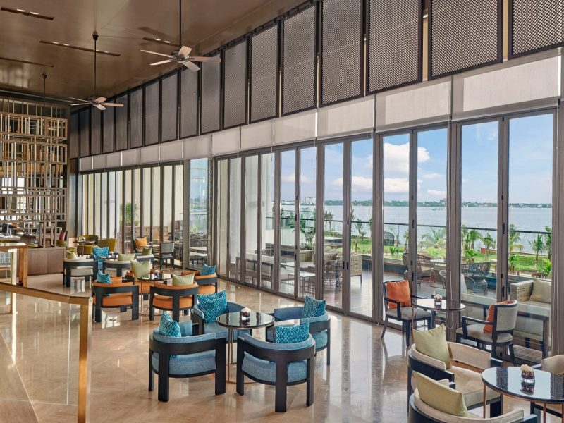colourful chairs and a view of the lake from the lobby lounge