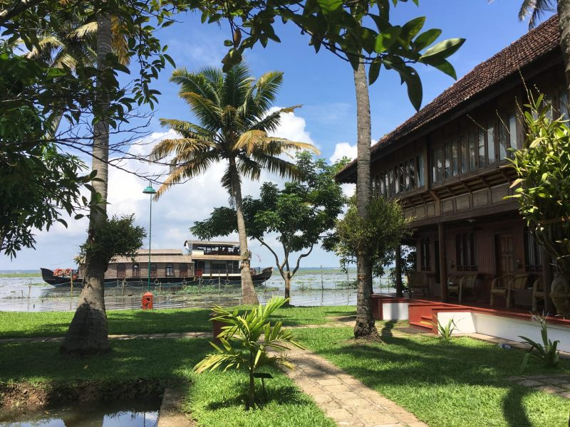 coconut lagoon resort heritage rooms with houseboat in Lake Vembanad in the background
