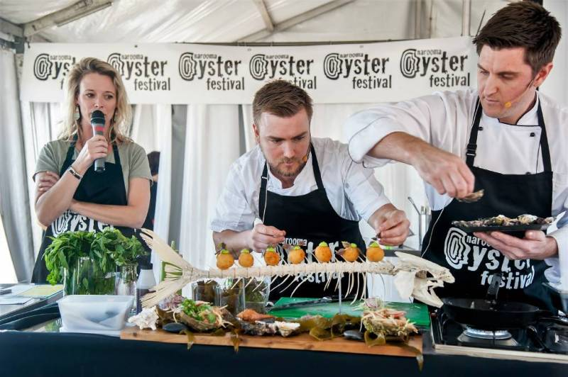 two chefs preparing gourmet dishes at the Narooma Oyster Festival