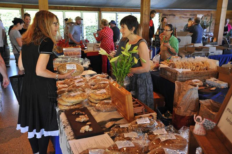 lady buying artisanal products inside the barn at Yarra Valley Farmers Market