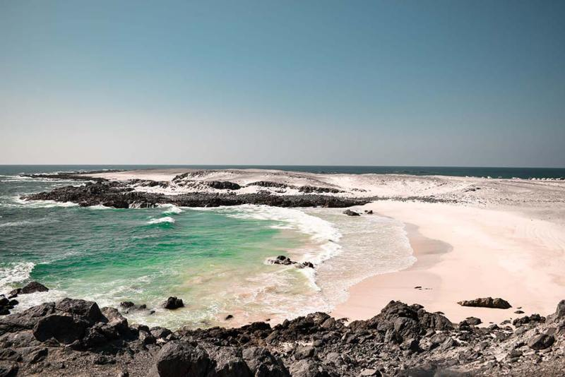 masirah beach in oman with emerald sea water and white sand as one of the best secluded beaches around the world