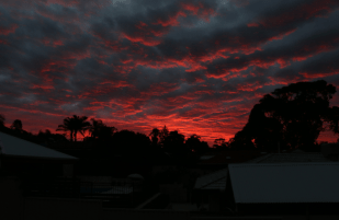Red clouds int he sky with grey directly above