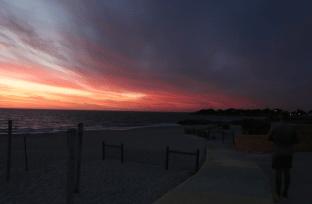Half storm half pink sunset