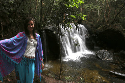 Tegan standing next to a waterfall in phu quoc