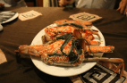 Fresh crab wrapped in seaweed and cooked by the locals on the table