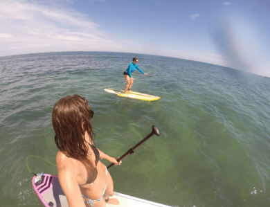 Tegan taking a selfie on the board out at cottesloe beach with Grete in the background. Super clear water