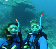 Underwater selfie infront of a huge piece of coral in the shape of a mushroom (bigger than us so at least 2m)