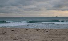 Dan surfing, cloudy skies