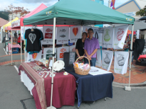 Aunty and uncle at their market stall in Nelson