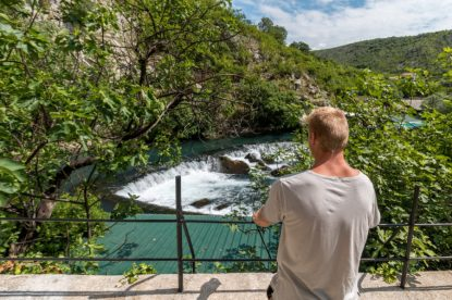 Dan looking out over the stream and waterfall in Blagaj