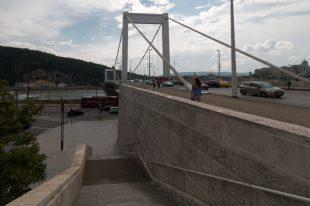 Tegan walking over the chain bridge