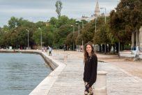 Tegan walking along the waterway