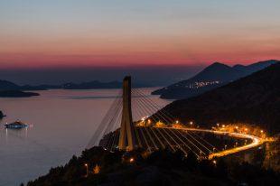 Bridge into Dubrovnik lit up at night