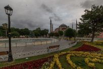 Yellow and red flowers, a water feature and in the distance the Hagia Sophia