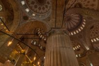 The colourful tiled roof inside of the blue mosque, swirls and patterns of every colour
