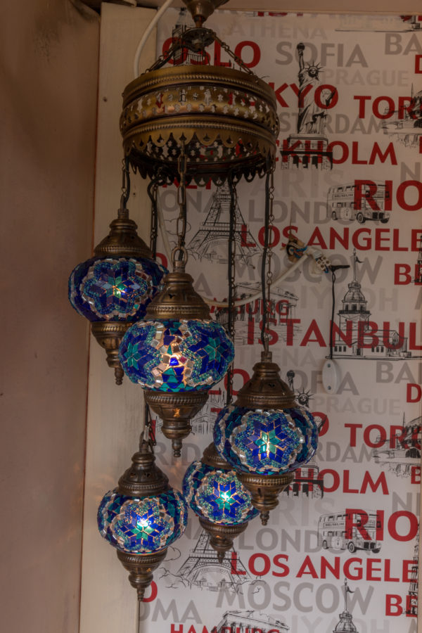 A beautiful blue turkish light, a big one at the top and 5 smaller ones varying in lengths spiraling below