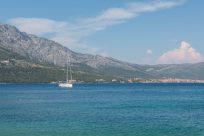 A yacht sailing the clear sea on a sunny day