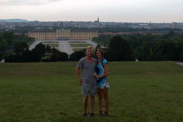 Couple shot on top of the hill looking back toward the palace