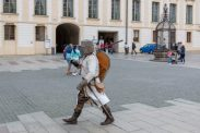 Someone dressed as a medieval knight walking through the castle area